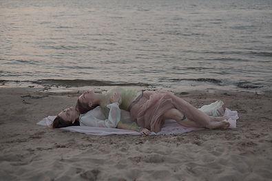 two woman nacked near water.jpg