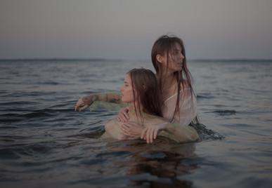 two women swim in the water.jpg