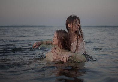 two women swim in the water.jpg
