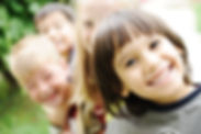 smiling-kid-in-foreground-with-blurred-o