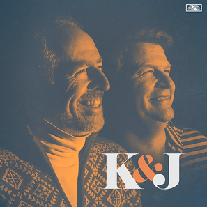 K&J Podcast Cover. A dramatic picture of Kevin and Jay smiling wearing patterned sweaters. The lighting is sharp and the photo has been edited to be shades of blue and orange. K&J is in the corner in bold script.