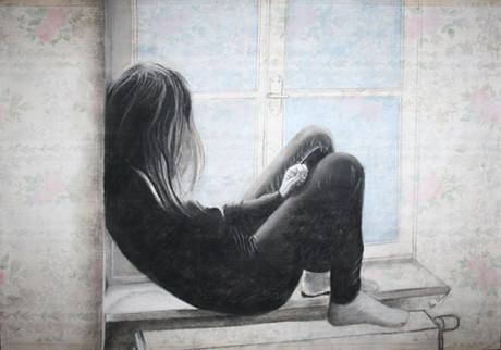 Meisje aan het raam