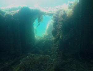 Looking through the walkway of the Empire Seamen shipwreck.