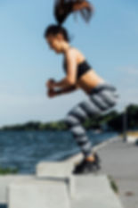 side-view-woman-doing-jumps_23-214825962