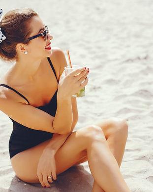 elegant-woman-sunny-beach_1157-20107.jpg