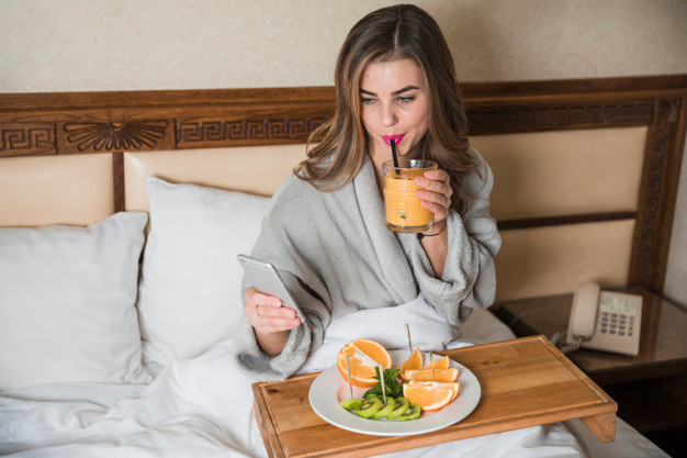 Woman in bed healthy food