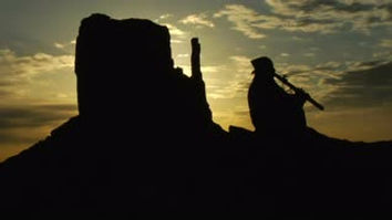 native-american-playing-flute-with-monum