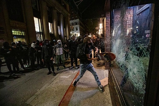 antifa smashing windows.jpg