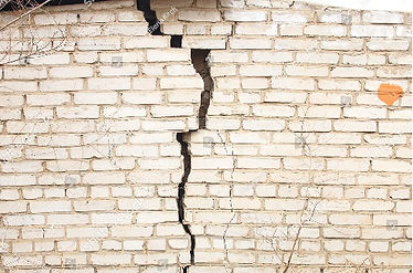 stock-photo--brick-wall-with-deep-fissur