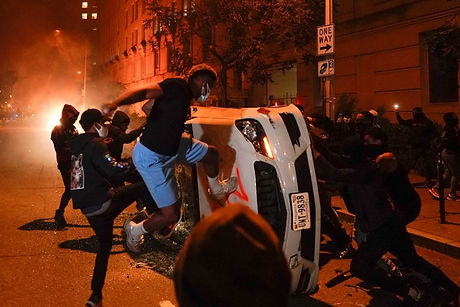 blm smashing cop car.jpg