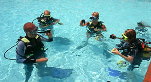 Instructor and students during scuba div