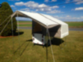 Kompact Kamp Mini Mate Camper with awning and fender lightbar.  Pull behind motorcycle camper