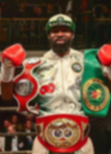 Larry win with belts.jpg