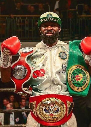 Larry win with belts.jpg