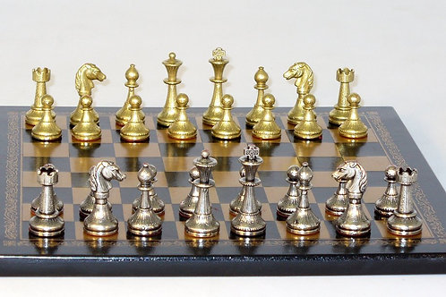 Small Staunton Chessmen on Leather Board by Ital Fama