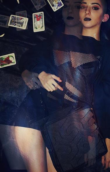 model styled with Phomaz handbag in Dollhouse Magazine