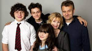 The Outnumbered cast: Ben Brockman (Daniel Roche); Jake Brockman (Tyger Drew-Honey); Karen Brockman (Ramona Marquez); Sue Brockman (Claire Skinner); and Pete Brockman (Hugh Dennis)