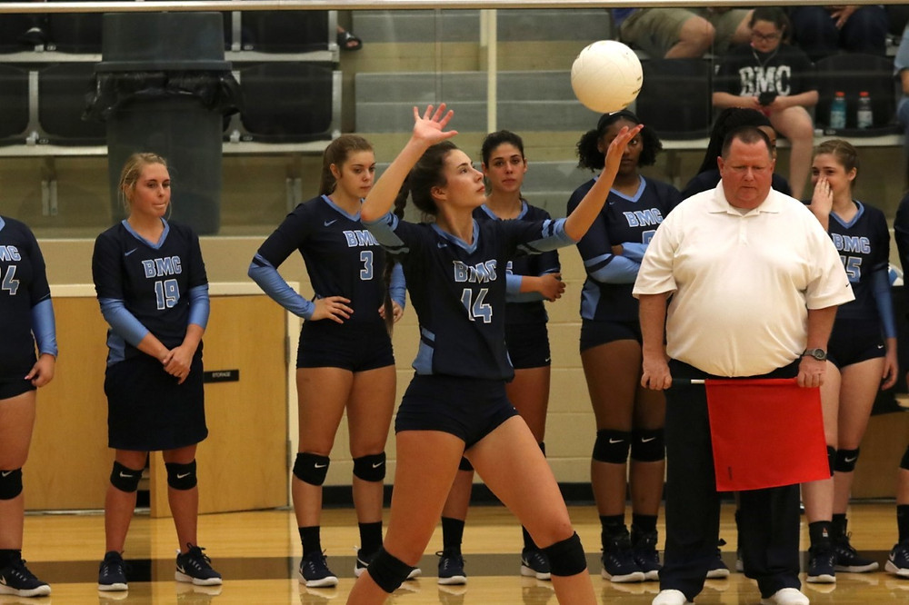 Volleyball player Saige Blanton serving to gain a point for BMC