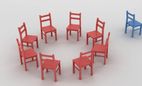eight red chairs in a circle and a blue chair sat facing away from the circle