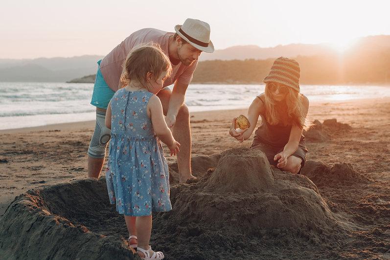 happy-family-having-fun-together-beach-s
