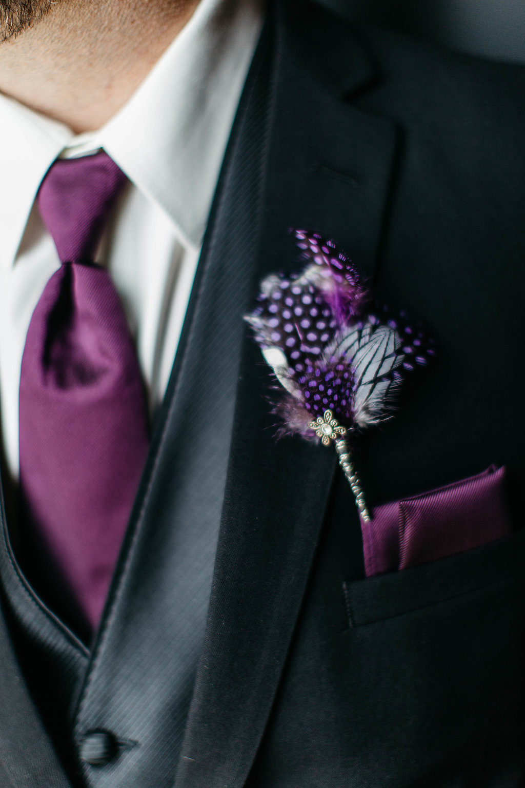 Purple feather buttonhole