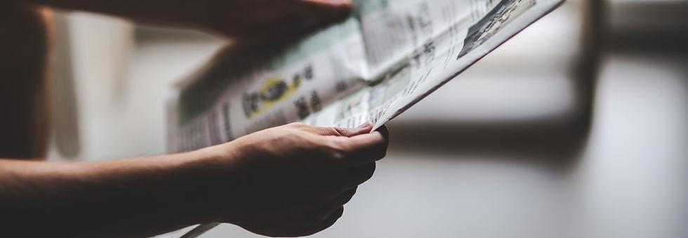 man-reading-newspaper_edited.jpg