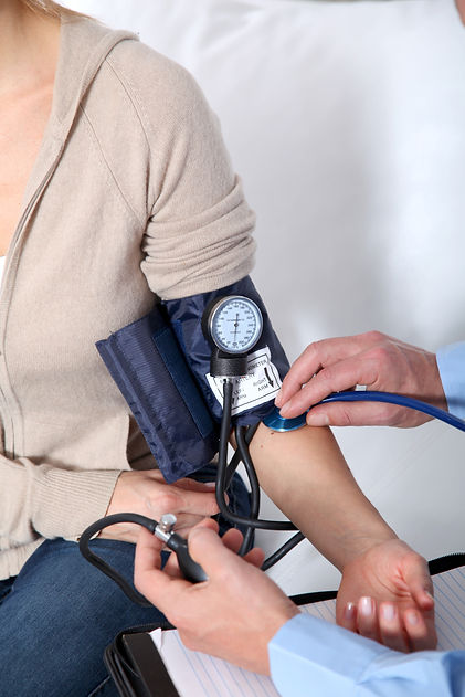 Doctor measuring blood pressure.jpg