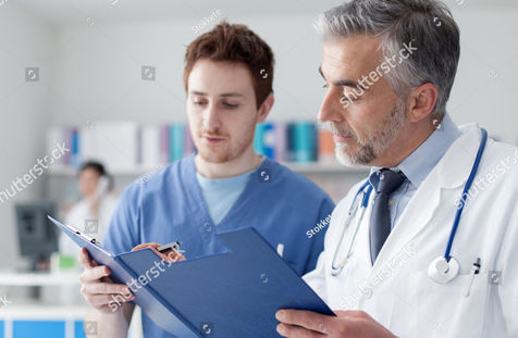 stock-photo-doctor-and-practitioner-exam