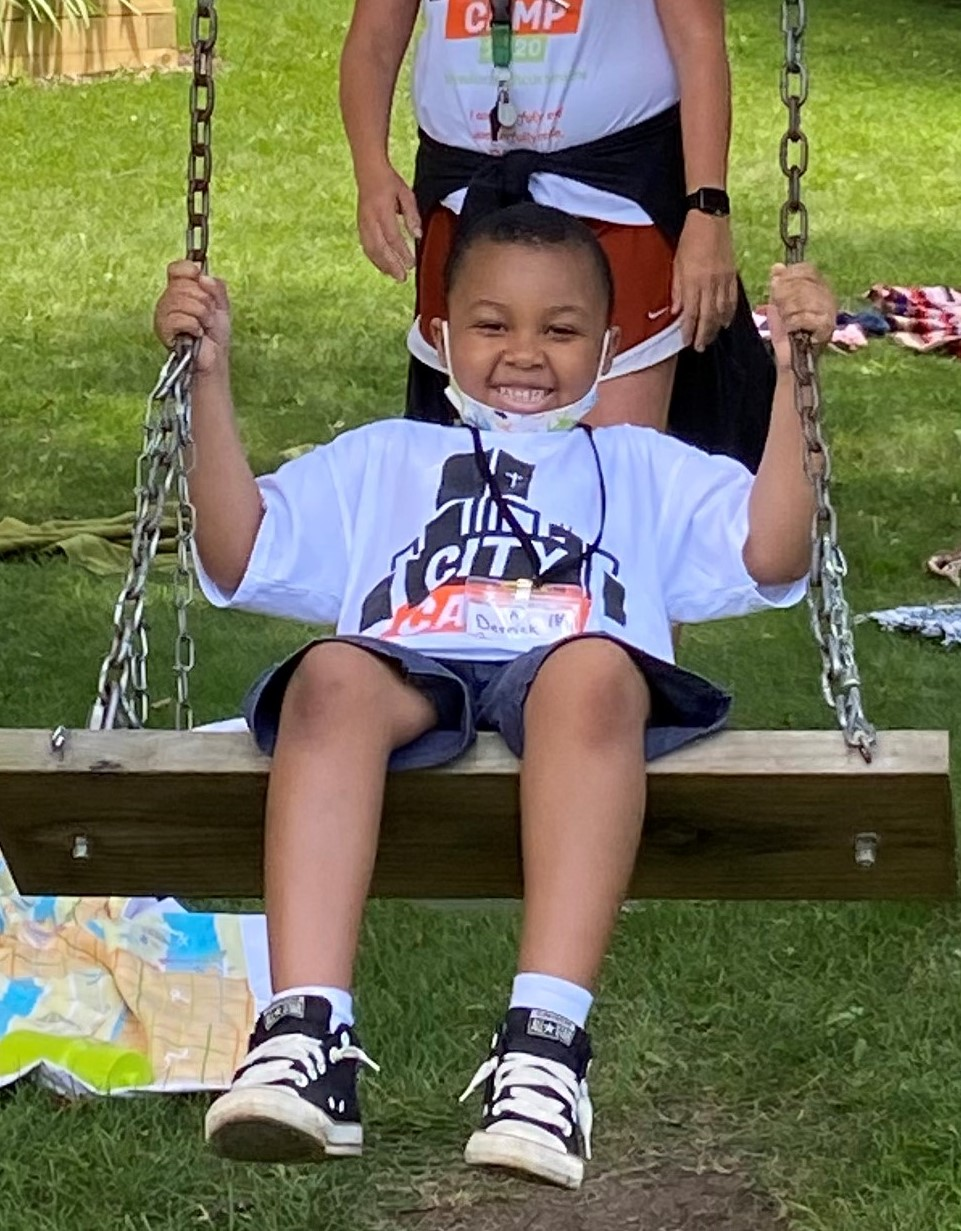 Boy Smiling on Swing MRM 2