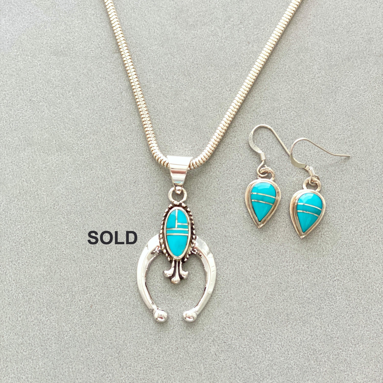 Small turquoise naja pendant
