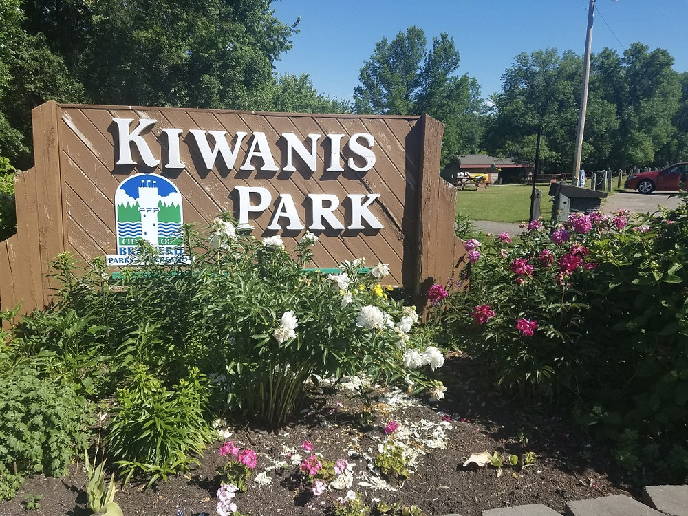 A flowered Kiwanis Park entrance sign Brainerd Minnesota