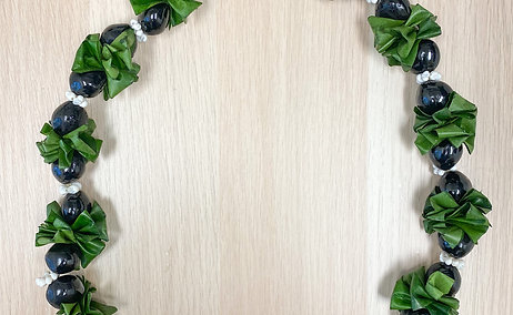 Ti Leaf Kukui Nut Lei with mongo shells or similar