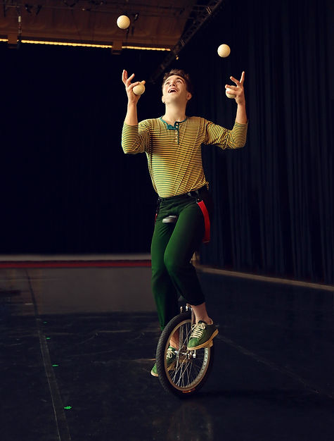man on a unicycle juggling_edited.jpg