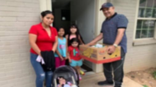 Eduardo Delivering Food to a Family in D