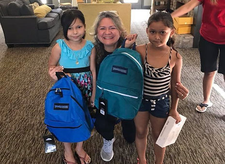 Sheila2 with Children giving Backpacks.j
