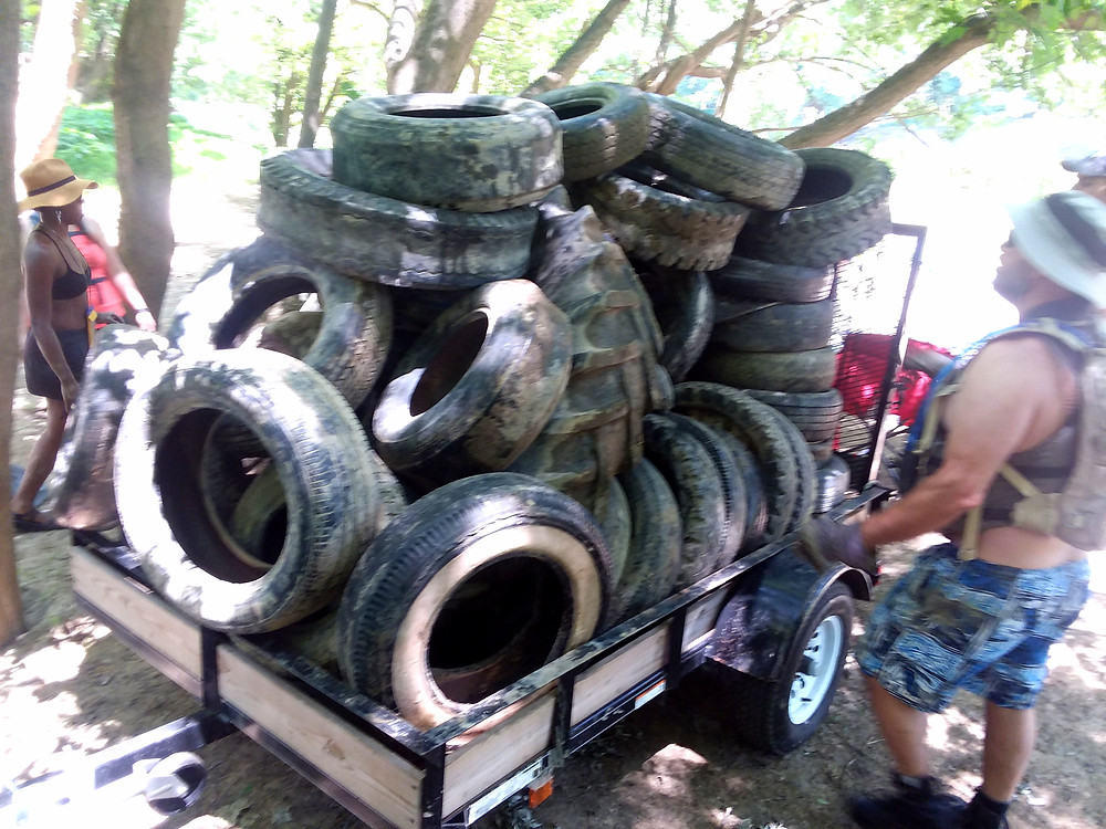REI Cincinnati staff bring in 51 tires from the Little Miami on June 6th! Many thanks!