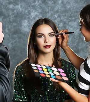 Professional makeup artist working with