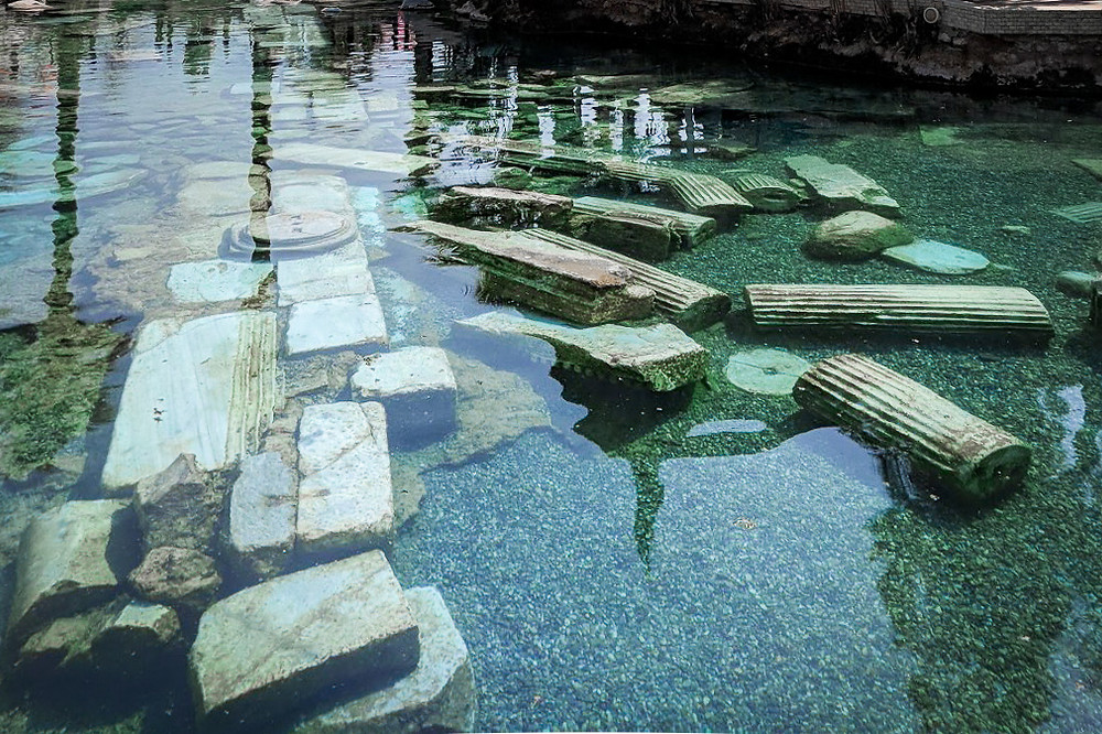 Original ruins from the Apollo Theater inside Cleopatras pool in Pamukkale, Turkey.