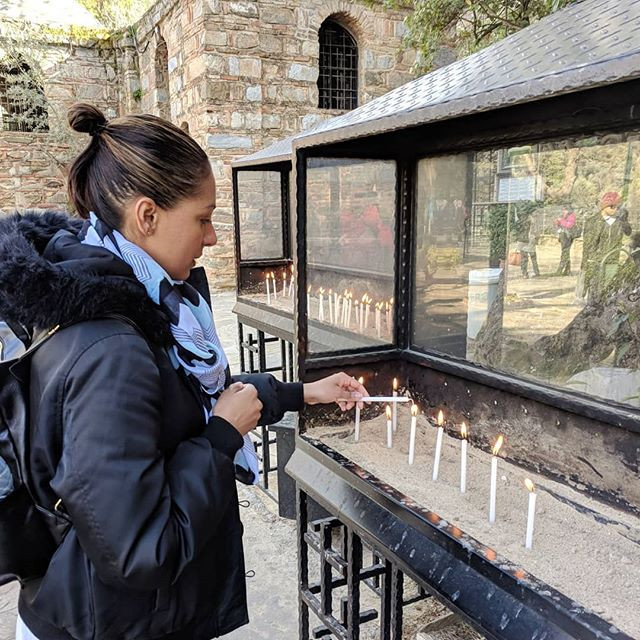 Lighting a candle at the house of Virgin Mary in Turkey.