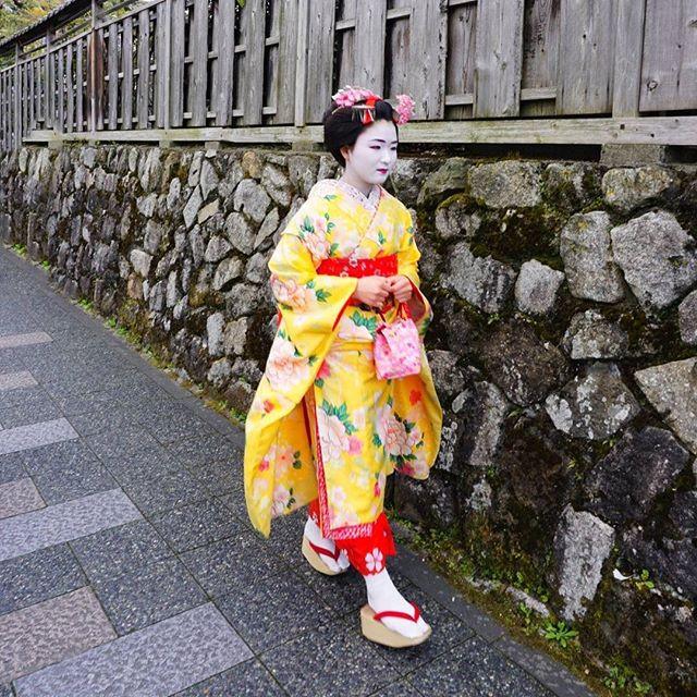 A geisha walking the streets of Kyoto.