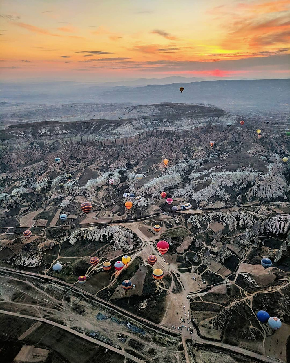 Watching the sunrise from inside a hot air balloon in Cappadocia.