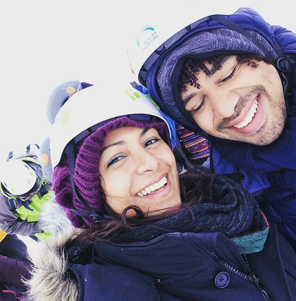 Adventure travel couple Naureen and Fernando Lamberty Ice caving in Iceland.