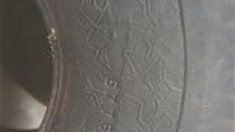 ~ 1748 2 ply tire. Still has rubber from being molded.