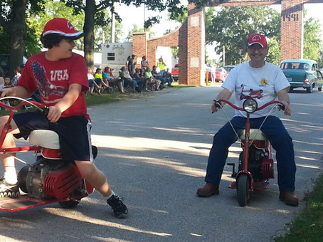 Can a Grandpa have any more fun this this–riding Doodle Bug Scooters with his grandson?