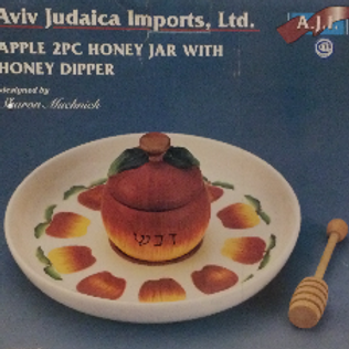 Rosh hashanah plate with honey dish and dipper