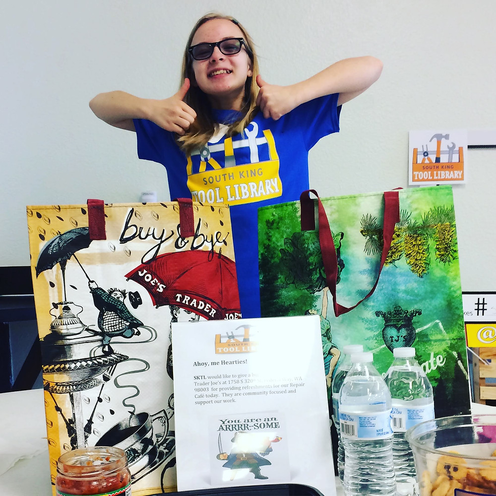 Young lady with totes and snacks generously donated by Trader Joe's