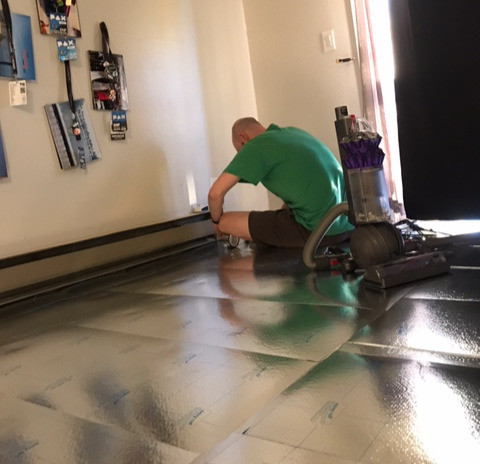 Zack sits on top of newly-installed underlayment sheets