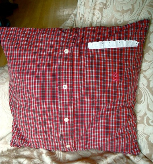A men's plaid shirt turned into a couch pillow