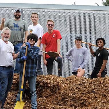 SQ volunteers digging