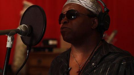 NEW Lee in recording studio red.jpg